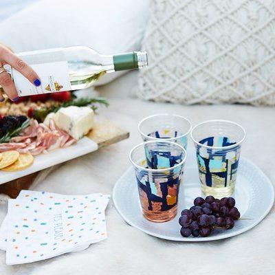 Golden hour calls for wine al fresco. 🍷 What's your favorite happy hour treat? Shop the #WhitforCheeky collection, including these paper collage-inspired cups, through the link in our bio. They're only $3.59!