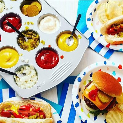 Great idea from @michaelsstores and @wiltoncakes - use a muffin tin for condiments and other fixins! Looking good with our @britandco for Cheeky confetti plates. #britgetscheeky
