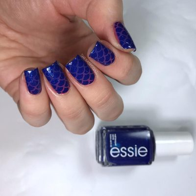 Not a new mani, but I was going through old photos and found this. Gawd I love that blue. Scale stencils were used to create these - and you can buy them at the link in my bio 💜 . . . #nails #nailblogger #nailart #polish #naturalnails #ottawablogger #essielove #essie #nailpolish #nailpolishaddict #nailvinyls #mermaidnails #mermaid