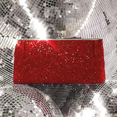 Add some sparkle under the Christmas tree, my Pocket Clutch is the perfect gift and EXCLUSIVE to my website and #VBDoverSt! Order before 3pm today with next day delivery to receive your gifts in time! x VB victoriabeckham.com #KissesatChristmas