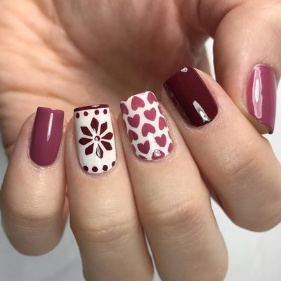 Fair Isle and heart nails inspired by @coffeeandnailpolish 💖 I used the heart pattern stencil and Fair Isle stencil from thebasecoat.com to create this look! . . . #nails #nailart #fairisle #heart #heartnails #fairislenails #pinknails #rednails #nailvinyls #nailstencils #nailsofinstagram #ottawa #nailedit #polish #thebasecoat