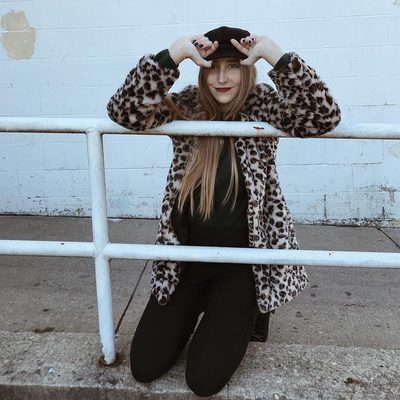 "We're getting major ""Where the Wild Things Are"" vibes from @katilyn_perry's cool cheetah-print coat. Click the link in our bio to see why a faux-fur jacket is the secret to your next #OOTDs this winter."