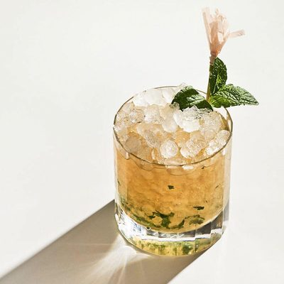 Kicking relaxation mode into overdrive with this CBD-infused Julep cocktail 🌿  What You Need 🍹 -2 1/2 ounces bourbon -1/2 ounce simple syrup -6 cannabis leaves and 2 mint leaves or 8 mint leaves + extra for garnish -15 mg CBD tincture  How to Make: 1. Muddle the leaves and simple syrup in a chilled julep cup.  2. Add the bourbon and top with pebble ice.  3. Swizzle, then top with more pebble ice.  4. Garnish with 3 cannabis leaves or 3 mint sprigs.  Bottoms up. #goopmake (Recipe courtesy of @beerghost)