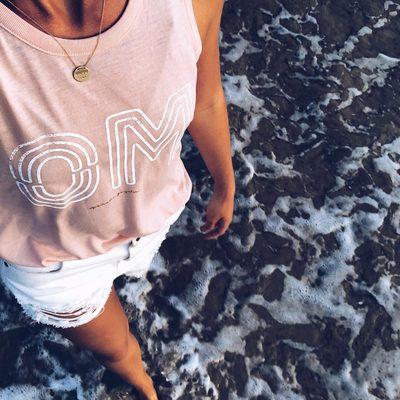 One with the ocean 🌊🙏@noshoes_noworries exploring in the Neon Om Studio Tank — link in bio to shop #om #weareallone #trusttheuniverse #spiritualgangster