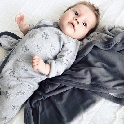 Fly away with me. We love this monochrome look sporting our Origami collection footie and blanket.  Tell us if you love monochrome for baby too? @blindseyj #finnandemma