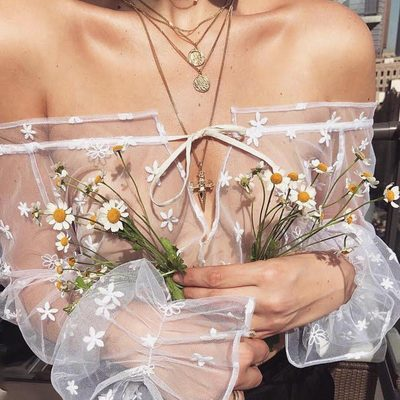Delicate tulle sprinkled with dainty daisy embroidery 🌼 The Claudia Tulle Blouse | @lili_claspe