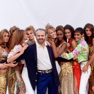 "Gianni Versace surrounded by a group of models in 1991. ""Gianni trained me to do everything,"" @Donatella_Versace told GQ. As the current head of the Italian design house that helped establish the intersection of fashion and pop, Donatella has maintained her singular influence on clothes and culture for 21 years. Visit the link in bio for more."