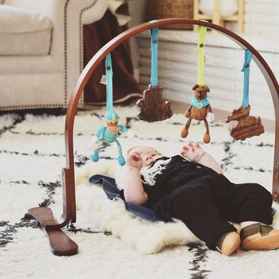 """Our viking playgym is in stock now!  Our height-adjustable play gym has a 100% birch wood frame finished with non-toxic stains and lacquers. The wooden teething toys are made from untreated indian hardwood and finished with vegetable seed wax. The knit toys were hand-knit at an artisanal women's collaborative in Peru using G.O.T.S. certified organic cotton yarn and wool stuffing. All play gym dolls are removable—they can be used away from the gym as stroller or carseat toys and all of our """"Stroller Sets"""" fit on the gym! Best of all, they'll never need a ride home at the end of the play date. @brittneyknudsen"""