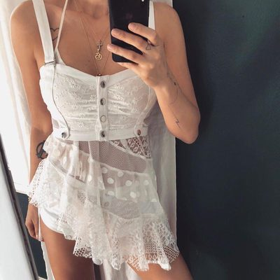Layers of eyelets, lace, & mesh 🍰 The Coco Tank Cover Up styles under the Daisy Eyelet Snap Up Bustier & Panty