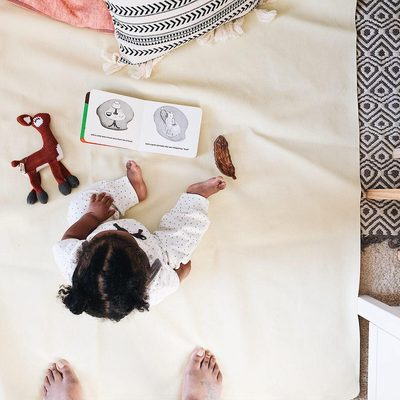 This image captures a Finn + Emma life.  Knit toys, wood toys and comfy high quality organic clothes. @bohomomtog #finnandemma