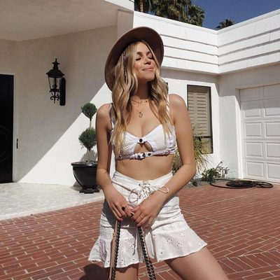 Sunkissed in eyelet lace 🕊@nitsanraiter wears the Daisy Eyelet Buckle Bustier & Lace up Mini Skirt