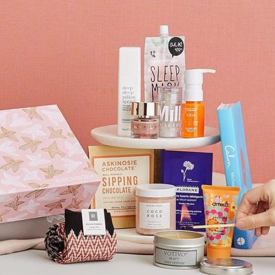 """Say """"Ahh"""". Consider our new How to Hygge Limited Edition Box your invitation to take a much-deserved staycation. 🛀 There's tranquility-inducing treats like a calming candle, a sleep-inducing pillow spray, and even cozy socks to get you into a 💆🏻 state of mind."""