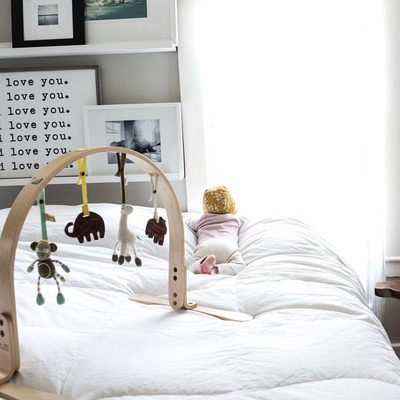 A penny for her thoughts?  Our play gym is light enough to carry through out the entire house so you little one can play with you in bed, in the living room or outside.  Made with 100% non toxic wood + Organic Cotton Knit toys.  Where is your play gym now? @moriziobrood #finnandemma