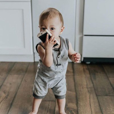Hello?  Hello?  Anybody there?  This little cutie looks great in our Origami Romper.  Rompers are the best summer basic. To place your order and get them before the next heat wave click on the link in the bio and then find this picture. @hellojessiemartin  #finnandemma