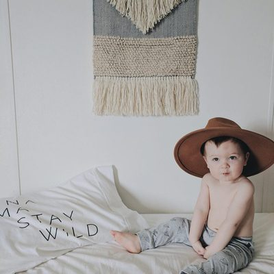 Our pants are 100% organic cotton.  Perfect for lounging and going out.  These origami printed pants are a lovely neautral that can be matched with a shirt that has a pop of color or nothing at all.  Like this little cowboy! @hellojessiemartin #finnandemma