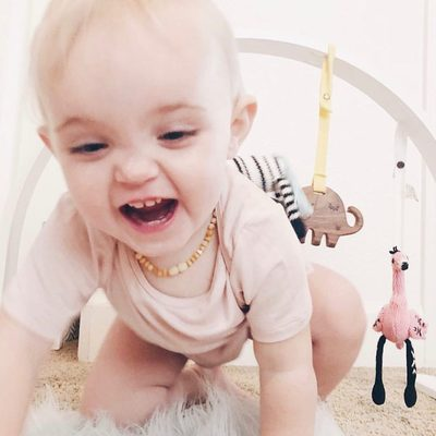 Sunday Funday! Our play gym is making an appearance and this little one smile.  Behind her is our Miami Zoo playgym with white frame. #finnandemma @tuesdaysays