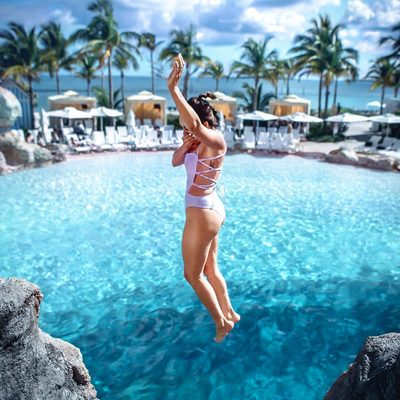 Jumping into the week w/ @frankvinyl 💦 Our apron tie back one piece is back by popular demand 👙 Link to swimsuit in bio! #swimwear #summer #monday #millydoesthebahamas