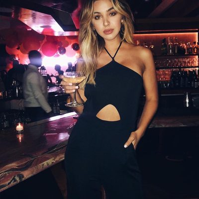This round is on me 🍸. @nadia_mejia in the Pia Jumpsuit. #revolvearoundtheworld