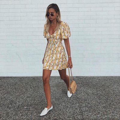 Hello sunshine @weworewhat in the Atlanta Mini Dress 🌼👟