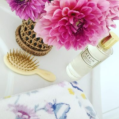 Back in stock our #AERIN small woven lantern ... Summertime style. Linen Rose fragrance inspired by summers in East Hampton. #AERINbeauty