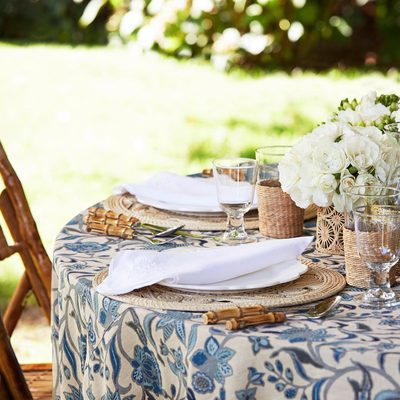 Is it Friday yet...? Create a classic summer table setting and shop the #AERIN white linen napkins enhanced with embroidery. Link in bio.