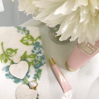 About last night... New heart @rderavenel earrings and AERIN Rose lip conditioner #AERINBeauty