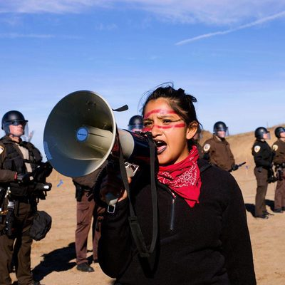 """A US Federal Judge has halted the Keystone XL Pipeline, saying that the Trump administration failed to present a """"reasoned explanation"""" for the move and """"simply discarded"""" the effect the project would have on climate change. The Dakota Access pipeline, funded by the Energy Transfer Partners corporation, would transport up to 570,000 tons of crude oil per day along a 1,172-mile route from the Bakken oil fields of North Dakota through South Dakota, Iowa, and Illinois. If completed, its path would cut through grounds sacred to the Standing Rock Sioux tribe. It would travel twice underneath the Missouri River, which the Lakota and Dakota people of the Standing Rock Sioux reservation depend on for drinking water, along with 17 million other people throughout the country. Tap the link in our bio for a look back on the Standing Rock Rising. Photographed by @alessandra_sanguinetti"""
